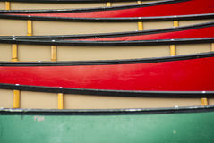 Canoes in rank and file. Caneos out of water in stock in rank and file stock photo