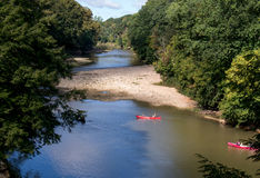 Canoes on the river Stock Photos