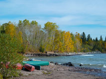 Canoes on Rocky Beach Stock Images