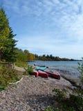 Canoes on Rocky Beach Stock Image
