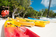 Canoes on sandy beach. Summer, canoes, activities and vacations concept - canoes on sandy beach royalty free stock photos