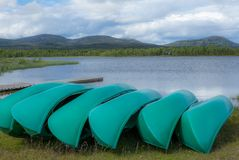 Canoes on the shore of a lake in the Rondane National Park in No Stock Photo