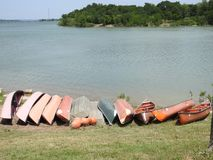 Canoes on the Shore of a Lake. In Texas Royalty Free Stock Image