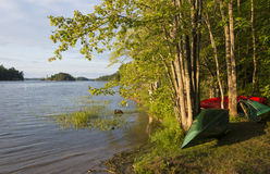 Canoes on the Shoreline Stock Photography
