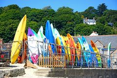 Canoes stacked on the harbourside, Lyme Regis. royalty free stock photos