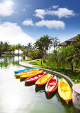 Canoes standby in resorts area, Brunei. Light-weight thermoset plastic canoes for outdoor water activity, standby in bright sunny day Stock Photography