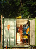 Canoes storage. Canoes for renting, stored in a shed in park stock photos