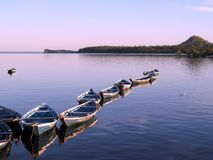 Canoes in sunset  Royalty Free Stock Photos