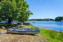 Canoes on Swedish sea coast Royalty Free Stock Photography