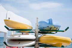 Canoes of various colors lay in the sand Royalty Free Stock Photo