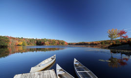 Canoes on Wah-Tuh lake, Maine, New England Stock Photos