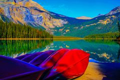 Canoes waiting at Emerald Lake. In soho National Park, British Columbia, Canada Royalty Free Stock Images