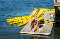 Colourful Canoes on a Pier. Canoes on a Wooden Floating Pontoon in a Harbour on a Sunny Day. Bar Harbor, ME, United States Royalty Free Stock Images