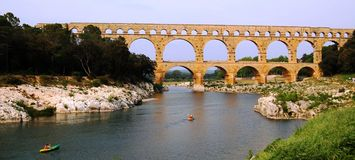 Canoing ancient roman aqueduct Royalty Free Stock Images