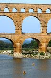 Canoing ancient roman aqueduct. Canoing near the ancient roman aqueduct in Provence, France Stock Image