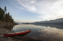 Canoe on shore. Canoe parked at twilight on Harrison Lake, British Columbia Royalty Free Stock Photography