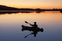 Canoist on lake Stock Image