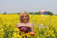 In canola field Stock Image