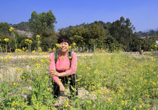 Canola field and cheerful woman Royalty Free Stock Photography