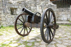 Canon. Antique canon, old metal weapon over wheel royalty free stock images