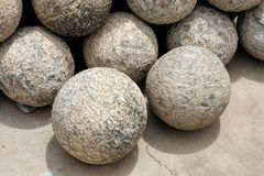 Canon balls made of granite rock Royalty Free Stock Photography