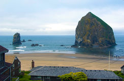 Canon Beach Oregon view of the central beach area with the main. Rock formation Stock Photography