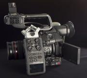 Canon C100 fläck II med den ljudsignal registreringsapparatzoomen H6 arkivfoto