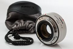 Canon camera converter lens and case Royalty Free Stock Photos