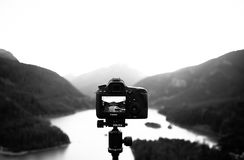 Canon camera photographing landscape Royalty Free Stock Images