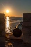 Canon dans le coucher du soleil Images libres de droits