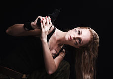 Canon de fixation de femme Photographie stock