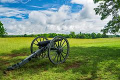 The Canon on Display in Field. Appomattox County, VA – June 3rd: A canon on display in a field on a beautiful spring day at The Appomattox Court House royalty free stock photo