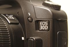 Canon EOS 30D. Close view of Canon EOS 30D digital camera body. Photo taken 05/2018 in Espoo, Finland black brand closeup design dslr equipment flash button royalty free stock photo