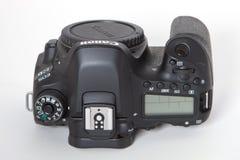 Canon EOS 80D DSLR camera. DSLR Camera - Canon 80D digital camera bodyon a reflective background Stock Photography