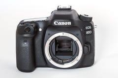 Canon EOS 80D DSLR camera. DSLR Camera - Canon 80D digital camera bodyon a reflective background Royalty Free Stock Image
