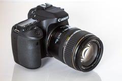 Canon EOS 80D DSLR camera. DSLR Camera - Canon 80D digital camera a reflective background Stock Photography