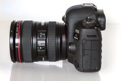 Canon EOS 5D Mark IV profesional DSLR photo camera on white reflective background Stock Photos