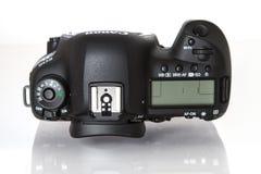 Canon EOS 5D Mark IV profesional DSLR photo camera on white reflective background Royalty Free Stock Image