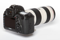Canon EOS 5D Mark IV profesional DSLR photo camera on white reflective background Royalty Free Stock Photos