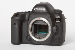 Canon EOS 5D Mark IV profesional DSLR photo camera on white reflective background Royalty Free Stock Photo