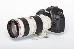 Canon EOS 5D Mark IV profesional DSLR photo camera on white reflective background Royalty Free Stock Photo