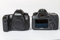 CANON EOS 5DSR and 5Ds DSLR 50 megapixels. Photo of CANON EOS 5DSR and 5Ds DSLR 50 megapixels, full frame photo camers side by side, on a white background Royalty Free Stock Image