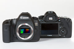 CANON EOS 5DSR and 5Ds DSLR 50 megapixels. Photo of CANON EOS 5DSR and 5Ds DSLR 50 megapixels, full frame photo camers side by side, on a white background, on a Royalty Free Stock Photo