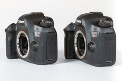 CANON EOS 5DSR and 5Ds DSLR 50 megapixels. Photo of CANON EOS 5DSR and 5Ds DSLR 50 megapixels, full frame photo camers side by side, on a white background, on a Royalty Free Stock Image