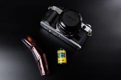 Canon film camera with Kodak slide film. A classic Canon AE-1 Program 35mm film camera with a roll of Kodak Echtachrome slide film and a developed film strip on Stock Image