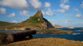 Canon and Hat Hill, Sueste Bay, Fernando de Noronha, Brazil Stock Images