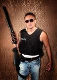 Canon hispanique de fixation de cop Photos stock