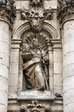Canon law. Allegory of canon law - religious legal regulations of Roman Catholic church. Detail of the facade - University of Valladolid, Spain stock photography