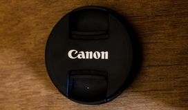 Canon lens cap. Logo highlighted canon Royalty Free Stock Images