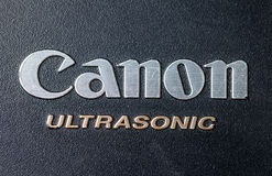 Canon logo on a lens cover Royalty Free Stock Photography